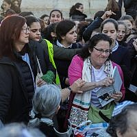 Members of the Women of the Wall prayer group hold prayers as thousands of ultra-Orthodox women protest against them at the Western Wall in the Old City of Jerusalem on March 8, 2019. (Hadas Parush/Flash90)