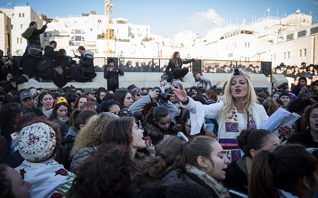Members of the Women of the Wall movement hold monthly prayers as thousands of ultra-Orthodox women protest against them at the Western Wall in Jerusalem Old City, March 8, 2019. (Hadas Parush/Flash90)
