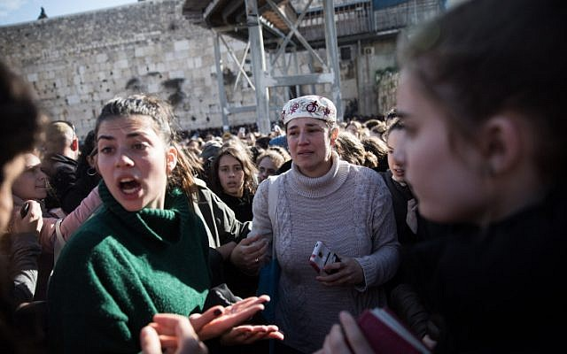 Members of the Women of the Wall movement hold Rosh Hodesh prayers as thousands of ultra-Orthodox women protest against them at the Western Wall in Jerusalem Old City, March 8, 2019. (Hadas Parush/Flash90)