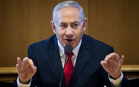 Prime Minister Benjamin Netanyahu speaks at a signing ceremony for an agreement to build new apartments in Jerusalem on March 11, 2019. (Aharon Krohn/Flash90)