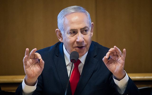 Prime Minister Benjamin Netanyahu speaks at a signing ceremony for an agreement to build new apartments in Jerusalem, on March 11, 2019. (Aharon Krohn/Flash90)