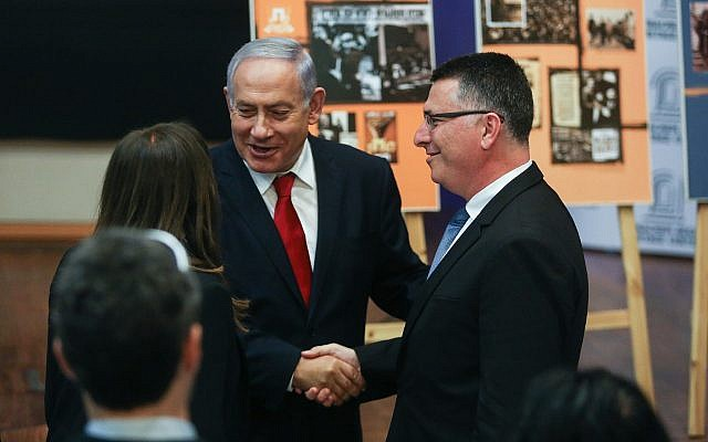 Prime Minister Benjamin Netanyahu shakes hands with Likud candidate Gideon Sa'ar as he arrives for a Likud faction meeting at the Menachem Begin Heritage Center in Jerusalem on March 11, 2019. (Yonatan Sindel/Flash90)