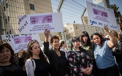 Protesters demonstrate on March 13, 2019, outside the Jeursalem District Court during extradition hearings for Malka Leifer, a former girls school principal wanted for sexual abuse in Australia. (Yonatan Sindel/Flash90)