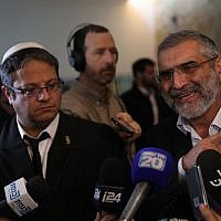 Otzma Yehudit party members Michael Ben Ari (R) and Itamar Ben Gvir speak to the media after a Supreme Court hearing on whether to disqualify them from running in the upcoming elections on March 14, 2019. (Hadas Parush/Flash90)