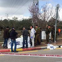 Israeli security forces at the scene where a Palestinian carried out a deadly attack near Giti-Avishar junction, March 17, 2019. (Flash90)