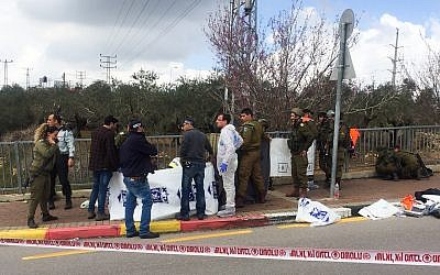 Israeli security forces at the scene where a Palestinian carried out a deadly attack near Gitai-Avishar junction, March 17, 2019. (Flash90)