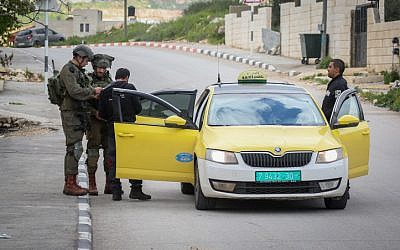 Israeli soldiers seen during a raid in the village of Bruqin near the West Bank town of Salfit on March 17, 2019, during searches for a Palestinian terrorist who shot and killed two near Ariel. (Flash90)