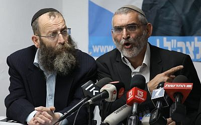 Otzma Yehudit party members Michael Ben Ari (R), and Baruch Marzel (L) speak during a press conference held in response to the High Court decision to disqualify Ben Ari's candidacy for the upcoming Knesset elections, in Jerusalem on March 17, 2019 (Yonatan Sindel/Flash90)