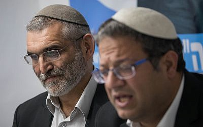 Otzma Yehudit party members Michael Ben Ari (L) and Itamar Ben Gvir attend a press conference held in response to the Supreme Court decision to disqualify Michael Ben Ari's candidacy for the upcoming Knesset elections, due to his racist views, in Jerusalem on March 17, 2019. (Yonatan Sindel/FLash90)