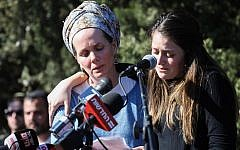 Family of Rabbi Achiad Ettinger, who was killed in a terror attack near Ariel on March 17, 2019, speak during his funeral at his home settlement of Eli, March 18, 2019. (Noam Revkin Fenton/Flash90)