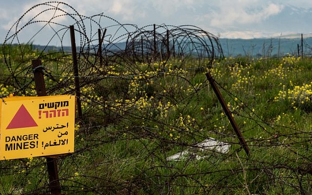 A warning sign of a minefield near the Syrian-Israeli border in the Golan Heights on March 25, 2019. (Basel Awidat/Flash90)