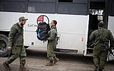 Israeli soldiers get out of a bus as they arrive to the Israel-Gaza border region of southern Israel on March 25, 2019. (Hadas Parush/Flash90)