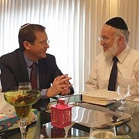 Jewish Agency head Isaac Herzog meets with Argentinean Chief Rabbi Gavriel Davidovich at his home in Buenos Aires. (Courtesy of Jewish Agency for Israel via JTA)