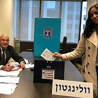 Anat Amichai, the wife of the head of security at Israel's embassy in Wellington, New Zealand, casting the first vote in the elections for the 21th Knesset, in early polling allowed for diplomats and their families, March 28, 2019. (Israel Foreign Ministry)