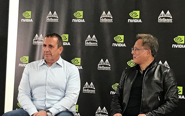 Eyal Waldman, left, founder and CEO of Mellanox and Jensen Huang, the founder and CEO of Nvidia Corp. at a press conference in Yokne'am, Israel, on March 25, 2019 (Shoshanna Solomon/Times of Israel)