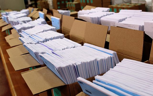 Voter lists at the Central Election Committee to be sent to polling stations ahead of election day, March 6, 2019. (Raoul Wootliff/Times of Israel)