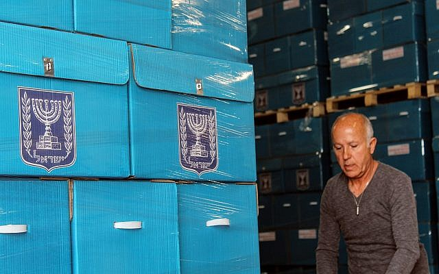 Central Election Committee workers prepare materials to be sent to polling stations ahead of election day, March 6, 2019. (Raoul Wootliff/Times of Israel)