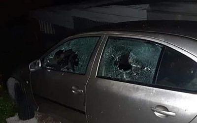 A Palestinian car damaged by rocks thrown at it, near the West Bank Palestinian village of Jinsafut, March 17, 2019. (Jinsafut Municipality)