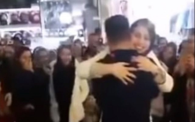 Screen capture from video of an Iranian couple whose public marriage proposal landed them in jail, Arak, Iran. (YouTube)