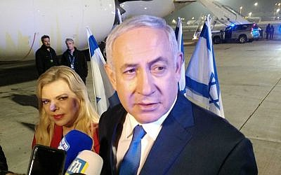 Prime Minister Benjamin Netanyahu, and his wife Sara, speaking to reporters before flying to Washington early on March 24, 2019. Raphael Ahren/Times of Israel)