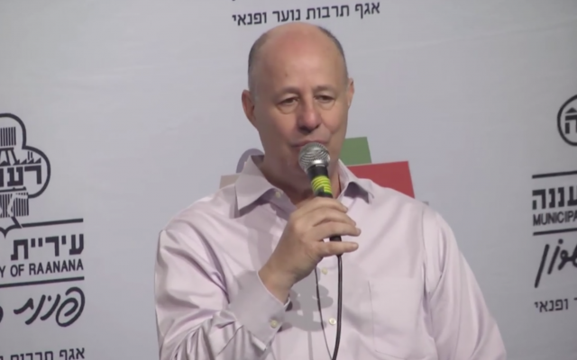 Tzachi Hanegbi speaks at a cultural event in Ra'anana on March 16, 2018. (Screen capture/Ynet)