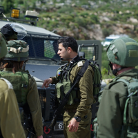 IDF soldiers near the scene of a shooting attack near the northern West Bank Ariel Junction on March 17, 2019. (Israel Defense Forces)