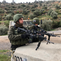 IDF soldiers near the scene of a shooting attack near the northern West Bank Ariel Junction on March 17, 2019. (IDF)