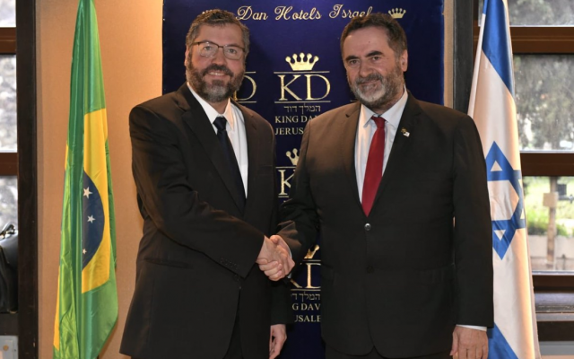 Acting Foreign Minister Israel Katz (R) shakes hands with Brazil Foreign Affairs Minister Ernesto Araujo, in the King David Hotel on March 31, 2019. (Twitter)