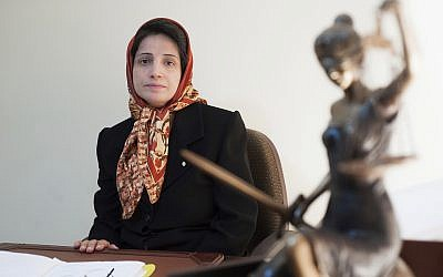 File photo of Iranian human rights lawyer Nasrin Sotoudeh in her office in Tehran, Iran on November 1, 2008. (AP/Arash Ashourinia)
