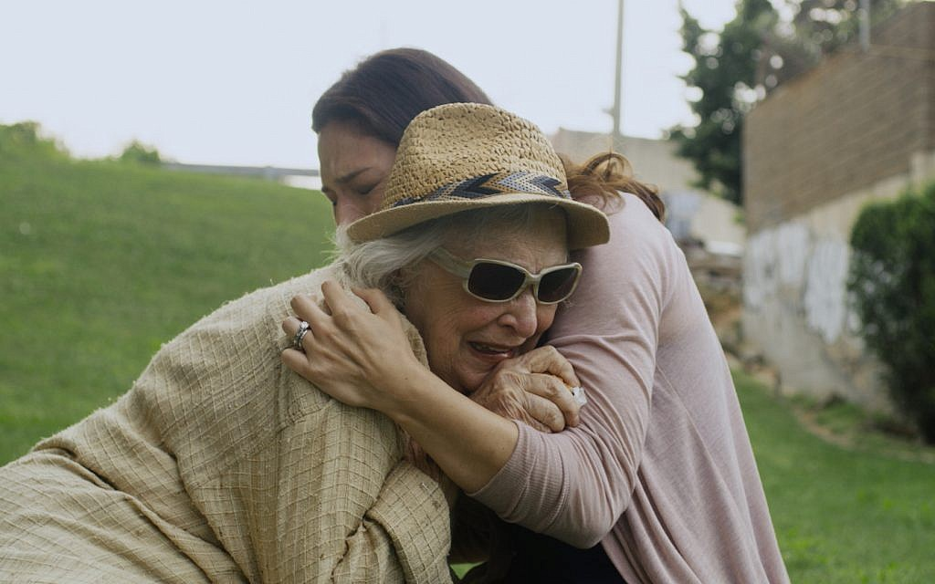 Olivia (Jill Durso) comforts great-grandmother Claire (Rebecca Schull) in 'The Last.' (Plainview Pictures)