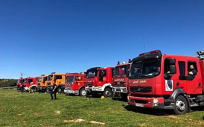 Israeli and Palestinian firetrucks in Jenin on March 19, 2019. (Credit: COGAT)