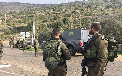 Israeli troops arrive at the scene of an alleged car-ramming attack in which two Israeli servicemen were injured in the central West Bank on March 4, 2019. (Israel Defense Forces)