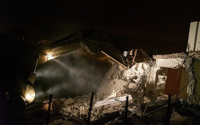 Israeli troops demolish the home of a suspected Palestinian terrorist, Asem Barghouti, in the West Bank village of Kobar on March 7, 2019. (Israel Defense Forces)