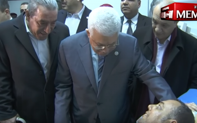Palestinian Authority President Mahmoud Abbas visits an injured Fatah official, Atef Abu Seif, in Ramallah on March 20, 2019. (YouTube screen capture)