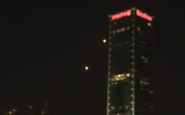 An Iron Dome interceptor is fired towards an incoming Gaza rocket against the backdrop of the Tel Aviv skyline, March 14, 2019 (video screenshot)