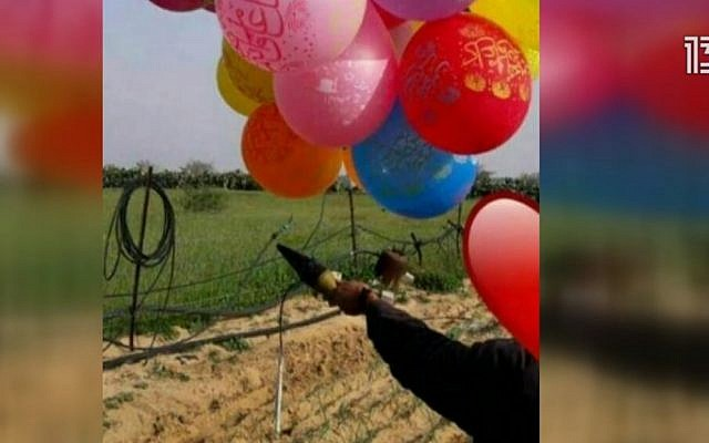 A screenshot from Channel 13 showing a cluster of balloons with what appears to be a warhead, Match 9, 2019.