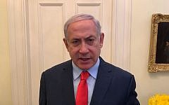 Screen capture of Prime Minister Benjamin Netanyahu in a Hebrew-language video released by his office from Washington on March 25, 2019, telling Israelis he would be heading back home following a Gaza rocket attack earlier in the day. (Courtesy PMO)
