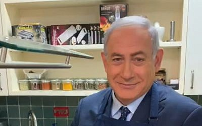 Prime Minister Benjamin Netanyahu fries eggs in an election video, March 2019. (Screen grab via Facebook)