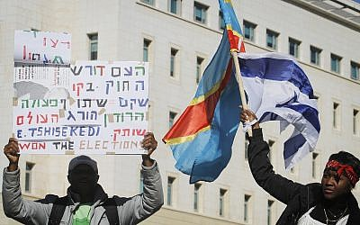 Congolese activists demonstrate outside Prime Minister Netanyahu's office in Jerusalem, calling for the Israeli government to disregard newly elected Congolese president Joseph Kabila and to support leader of opposition Etienne Tshisekedi as new president, on December 18, 2011. (Miriam Alster/FLASH90)