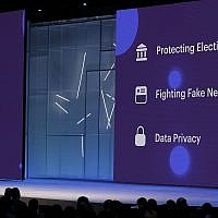 Facebook CEO Mark Zuckerberg makes the keynote address at F8, Facebook's developer conference in San Jose, Calif, on May 1, 2018. Facebook says it's expanding its fact-checking program to include photos and videos as it fights fake news and misinformation on its service. (AP Photo/Marcio Jose Sanchez, File)