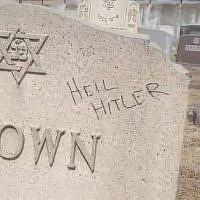 A defaced gravestone at a Jewish cemetery in Fall River, Massachusetts, in a video published on March 20, 2019. (screen capture: Washington Post)