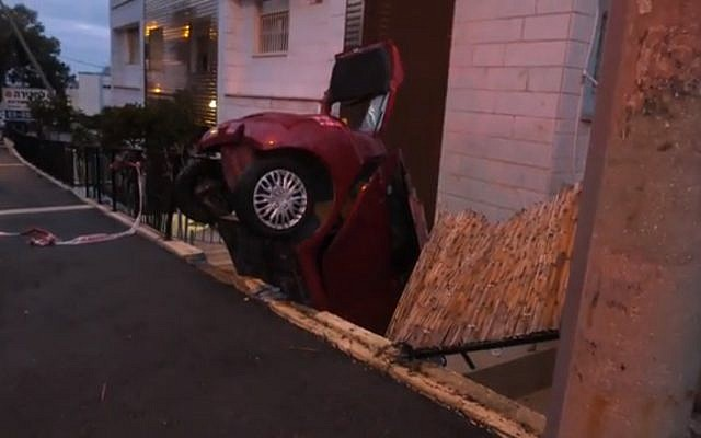 Car crashes into Haifa courtyard, March 2, 2019. (Screen grab via Ynet)