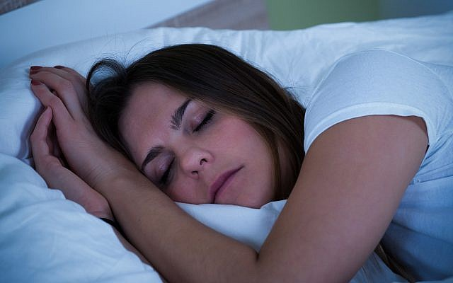 Illustrative image of a sleeping woman (AndreyPopov; iStock by Getty Images)