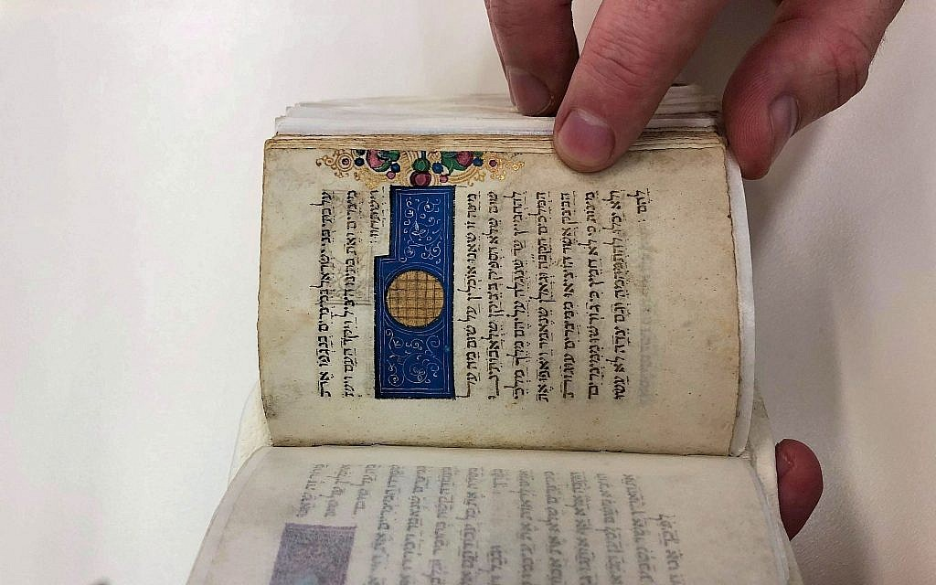 A page from the Passover Hagaddah, found in the 1480 'women's' prayer book scribed by Rabbi Abraham ben Mordecai Farissol in Italy, on March 3, 2019 at the National Library of Israel. (Amanda Borschel-Dan/Times of Israel)