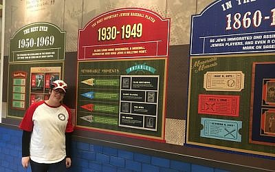 An exhibit at the Jewish baseball museum at Milt's Extra Innings in Chicago. At left is deli worker Zahava Auerbach. (Ellen Braunstein via JTA)