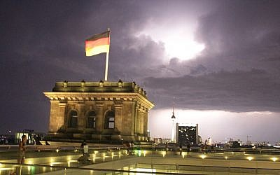 Illustrative photo of the German flag flying on the Reichstag buildin in Berlin (Ori Lewis)