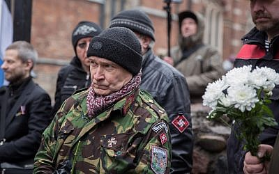 A man taking part in a march to honor member of the Latvian Legion SS units in Riga, Latvia, on March 16, 2019. (Courtesy: JFDA e.V. / Grischa Stanjek(