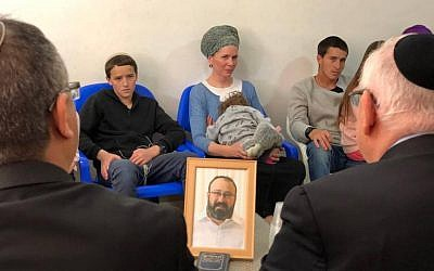 President Reuven Rivlin (right, back to camera) visits on March 20, 2019, the family of Rabbi Achiad Ettinger, one of two Israelis killed in a Palestinian terror attack on March 17. (President's spokesperson)