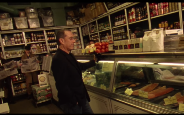 """Jerry Seinfeld hanging out in the Barney Greengrass deli on New York City's Upper West Side, in the music video for Vampire Weekend's song """"Sunflower."""" (YouTube screen capture via JTA)"""