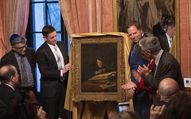 "The 1639 painting by Salomon Koninck titled ""A Scholar Sharpening His Quill"" looted by the Nazis from the Schloss family during World War II, is unveiled on April 1, 2019 at the French Consulate in New York City. (Photo by Don Emmert / AFP)"